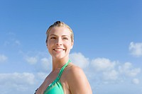Young Woman Smiling Under Blue Sky