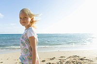 Portrait of girl smiling and looking at camera on beach