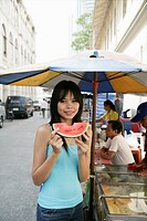 Thai woman with a slice of water melon, Bangkok,Thailand, Southeast Asia, Asia