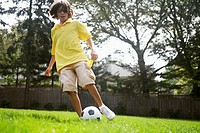 Boy 12_13 playing with soccer ball