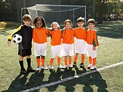 Children standing in soccer field portrait