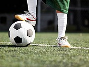 Child's foot on soccer ball close_up