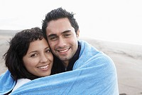 Young couple wrapped in towel portrait