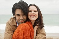 Young couple at beach portrait