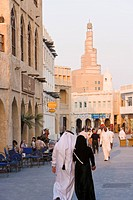 The restored Souq Waqif looking towards the spiral mosque of the Kassem Darwish Fakhroo Islamic Centre based on the Great Mosque in Samarra in Iraq, D...