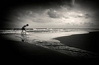 Boy playing in the beach