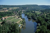 The River And Rows Of Houses In France