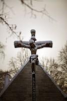 Close_up of snowcovered Crucifix by church Gravvårdarpå Norra Kyrkogården