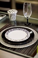Close_up of a plate with a wine glass