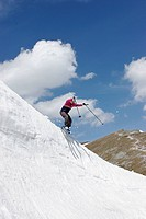 Touring skier jumping down snow cornice on mountain Rax Lower Austria Austria