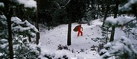 Tomte I Skogen Med Lykta, Santa Claus Carrying Sack Of Presents Walking Through Snow