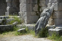 Ancient Greece headless figure of a woman made of stone leans at a wall Asklepieion Island of Kos Greece