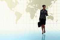 Businesswoman carrying briefcase with digital montage of world map