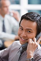 Portrait of smiling businessman on telephone