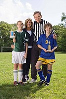 Portrait of family with soccer trophies