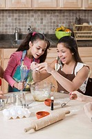 Girls baking in kitchen