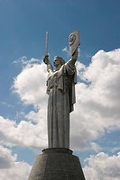 Ukraine Kiev mother of native country monumental memorial 1982 made in steel sword and shield shining close up blue sky with clouds 2004
