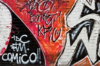 Red, black and white graffiti on a wall in Barcelona (Spain).