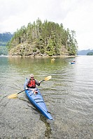 Kayaking in fjord