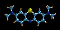 Methylene blue, molecular model. Atoms are represented by spheres carbon: light blue, nitrogen: dark blue, sulphur: yellow, hydrogen: mustard with the...