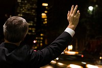 Businessman hailing a cab (thumbnail)
