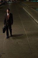 Japanese businessman walking at night