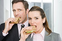 Colleagues eating sandwiches