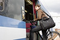 Man with bike getting onto train
