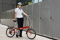 Woman with bike by lockers (thumbnail)