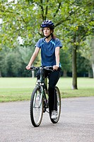 Woman riding bicycle (thumbnail)