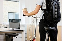 Person in office with bike