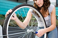 Woman with bike wheel