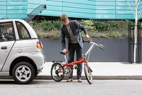 Man with folding bicycle