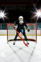Businessman playing ice hockey (thumbnail)