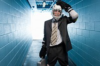 Businessman wearing an ice hockey uniform