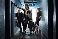 Three businessmen in ice hockey uniforms