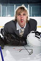 Injured businessman playing ice hockey