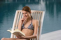 Woman reading a book on vacation