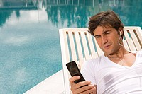 Man listening to music on cellular phone