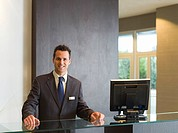 Smiling man in a hotel reception