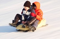 Two boy on a bobsled