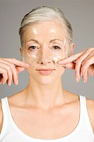 Woman with anti_aging face mask
