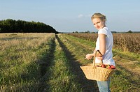 Woman in field with basket