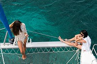 Young women on a catamaran