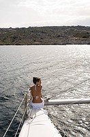 Young woman on catamaran