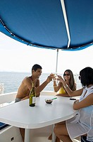 Friends having wine on boat