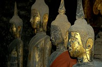 Golden Buddha statues made of wood in monastery Wat Wisunalat Luang Prabang Laos
