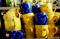 Yellow und blue cups for selling, Auer Dult fair, Munich