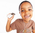 Young girl listening to music through head phones