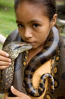 Girl with anaconda, Quistococha, Iquitos, Peru